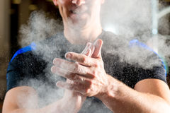Male hands smeared talcum powder Stock Images
