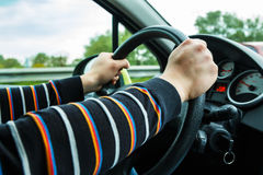Male hands on steering wheel Stock Photography