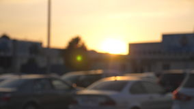 Male hands in suit giving keys of car to his friend at sunset time. Arm of businessman passes car key at evening. Handshake between two business men outdoor stock footage