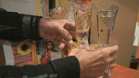 Male hands take the wedding glasses from the table stock footage