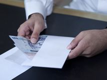 Male Hands taking money out of an envelope Royalty Free Stock Photography