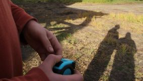 Male hands with a tape measure measure the land.  stock video