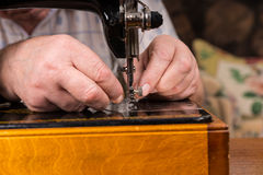 Male Hands Threading Needle of Sewing Machine Royalty Free Stock Photos