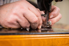 Male Hands Threading Needle of Sewing Machine Royalty Free Stock Photo