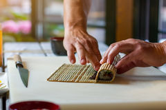 Male hands touch bamboo mat. Stock Photo