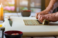 Male hands touching bamboo mat. Royalty Free Stock Image