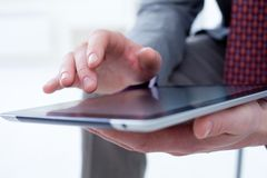 Male hands touching digital tablet Royalty Free Stock Image