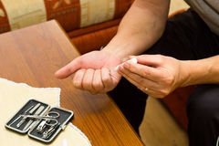 Treatment of warts. Male hands when treating warts using the applicator stock photo