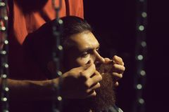 Male hands twist moustache stock images