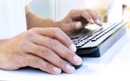 Male hands typing on a keyboard. Royalty Free Stock Photos