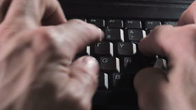 Male hands typing on a english computer keyboard stock video footage