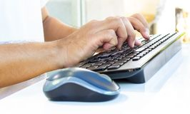 Male hands typing on a keyboard. Royalty Free Stock Image