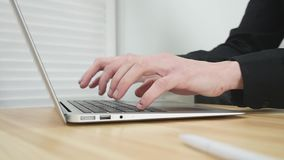 Male hands typing on a laptop.  stock video