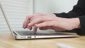 Male hands typing on a laptop.  stock video footage
