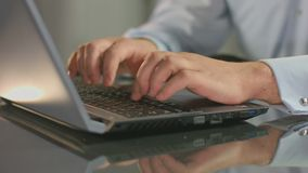 Male hands typing on laptop, guy working at office overtime. HD stock footage