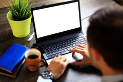 Male hands typing on laptop keyboard Royalty Free Stock Image