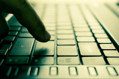 Male hands typing on laptop keyboard Royalty Free Stock Photo