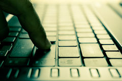 Male hands typing on laptop keyboard Stock Image