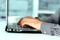Male hands typing on laptop keyboard Stock Photos
