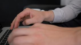 Male hands typing on laptop, side view. Male hands typing on laptop, side view stock video footage