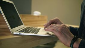 Male hands typing something on laptop keyboard and scrolling web pages. Male hands typing something on laptop keyboard and scrolling web pages stock video footage