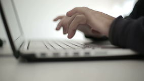 Male hands typing text on keyboard of laptop. Close up stock video