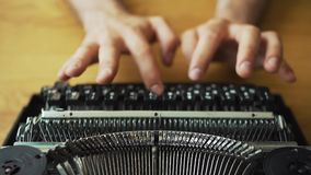 Male hands typing on vintage typewriter stock footage