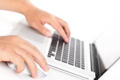 Male hands using computer. Stock Images