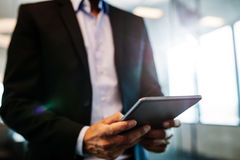 Male hands using digital tablet in office. Close up of male hands using digital tablet in office. Businessman man hand using tablet device Stock Photos