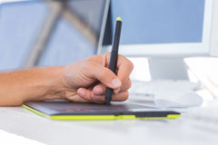 Male hands using a graphics tablet Royalty Free Stock Image