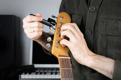 Changing electric guitar strings royalty free stock photos