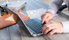 Male hands using a laptop Stock Photo