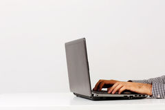 Male hands using on the laptop Royalty Free Stock Images
