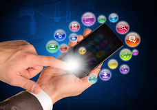 Male hands using smartphone. Application icons are. Flying around. Communication concept Royalty Free Stock Photo