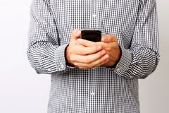 Male hands using smartphone Stock Photo