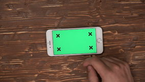 Male hands using smartphone with green screen stock video footage