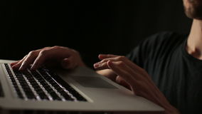Male hands using touchpad laptop close up black background. Man hands uses laptop touchpad close up black background stock video footage