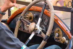 Male hands on vintage classic car steering wheel. Male hands on old classic car steering wheel stock images