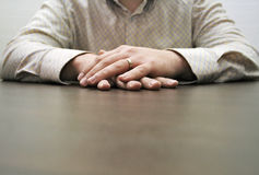 Male hands waiting. Male hands on a brown table waiting for a partner for discussion Royalty Free Stock Photography