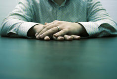 Male hands waiting. Male hands on a brown table waiting for a partner for discussion Royalty Free Stock Image