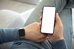 Male hands with watch holding phone with  screen. Male hands with watch holding phone with   screen royalty free stock photo