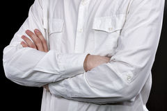 Male hands in white shirt folded on his chest closeup Stock Photo