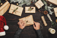 Male hands who is making Christmas presents Stock Photos