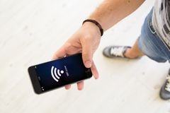 Male hands wifi zone smartphone. Closeup of male hand using smartphone wifi zone Royalty Free Stock Images