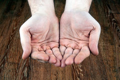 Male hands on a wooden background. Close up Royalty Free Stock Image