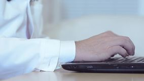 Male hands working on the laptop, close-up. Male hands working on the laptop, close-up stock footage