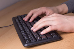 Male hands working with keyboard Stock Images