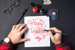 Male hands writing a Valentines day card. Calligraphy Royalty Free Stock Photo