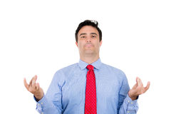 male, handsome businessman with blue shirt and red tie in meditation pose, relaxing, in zen Royalty Free Stock Photo