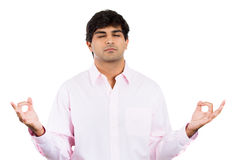 Male, handsome businessman with pink shirt in meditation pose, relaxing, in zen Royalty Free Stock Photography